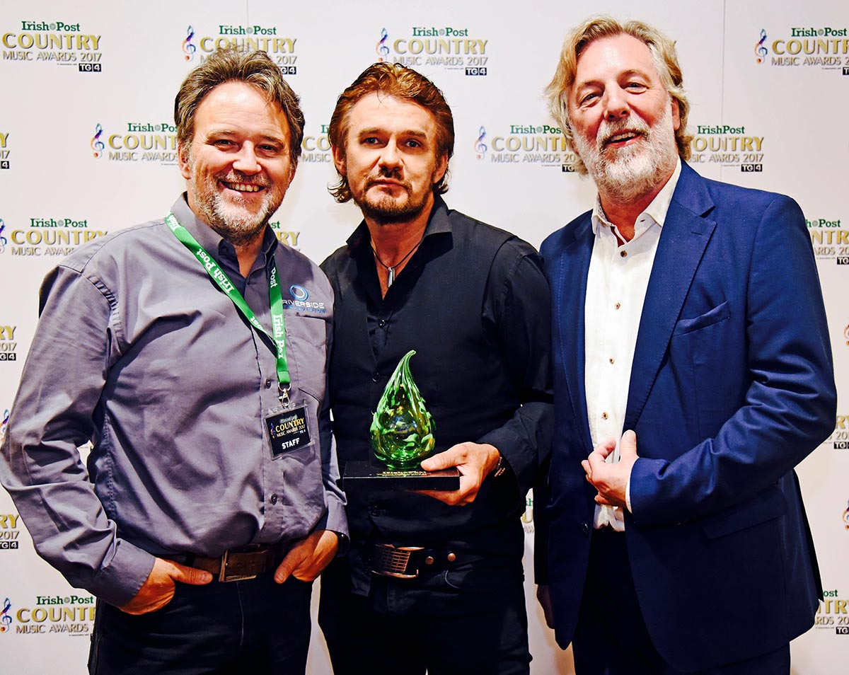 Don Mescall with his ICPMA Award for Songwriter of the Year with Stephen Macken TV Director and Dave Loader of NHM Publishing